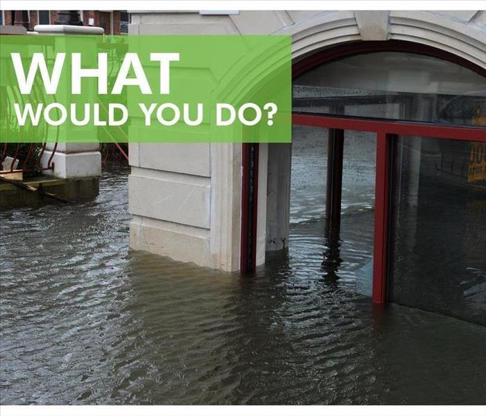 Flooded building. Sign that says WHAT WOULD YOU DO?